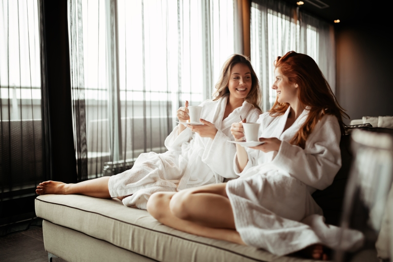 Two women share hotel room and use saved budget for spa experience together. They become the best of friends.